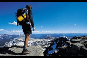 man on top of mountain hiking